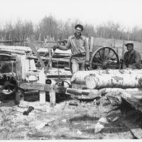 Three men at the sawmill