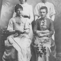 Two women standing, two sitting