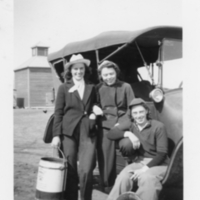 Lenna, Vera and Doris sitting on a vehicle