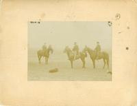 [Man and two boys on horseback]