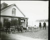 [N.W.M.P. officers with six-dog team]