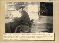 Corporal A. N. Nicholson, N.W.M.P. at desk, North Battleford, 1905.
