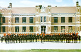 "Royal Canadian Mounted Police members of famous ""Musical Ride"" in ""V"" shape formation in front of Administration Building, Royal Canadian Mounted Police Barracks, Regina, Saskatchewan, Canada"