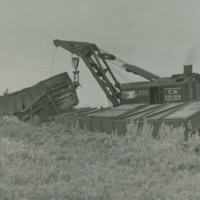 [Crane lifting wreckage]