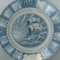 """1930"" blue and white china calendar plate ""Compliments of Shapira & Adelman"""