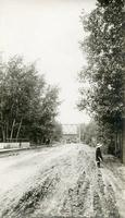 [View of road under the old railway bridge in Saskatoon]