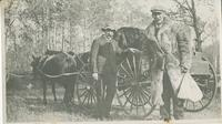 A buggy and two men (W. and C. Couper)