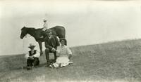 [People posing for a photograph with horse]