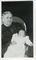 [Woman holding infant]