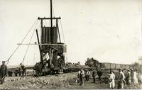[Laying railway track with machine]