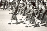 Women's military unit marching in the Torch Day Parade,