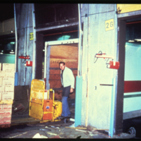 [Man loading Co-op truck at flour mill]
