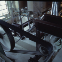 [Belt-drive and machinery inside a flour mill]