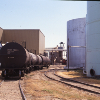 Tank cars next to oil storage tanks ready to move oil, CSP Nipawin