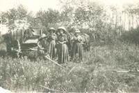 [Four women in front of a wagon]