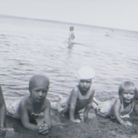 [Four little girls in bathing suits]