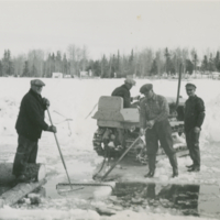 [Men cutting ice from lake]